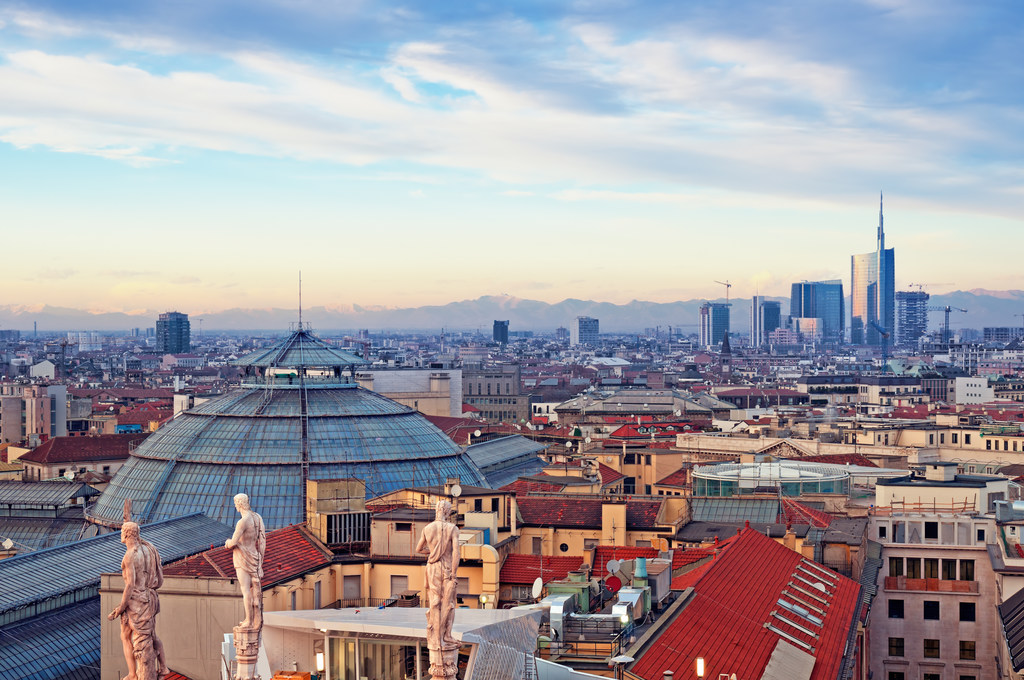 "View of Milan from the rooftop of  ""Duomo di Milano"". Statues of  Duomo of Milan, Galleria Vittorio Emanuele II and skycrapert of Porta Nouva also visible."