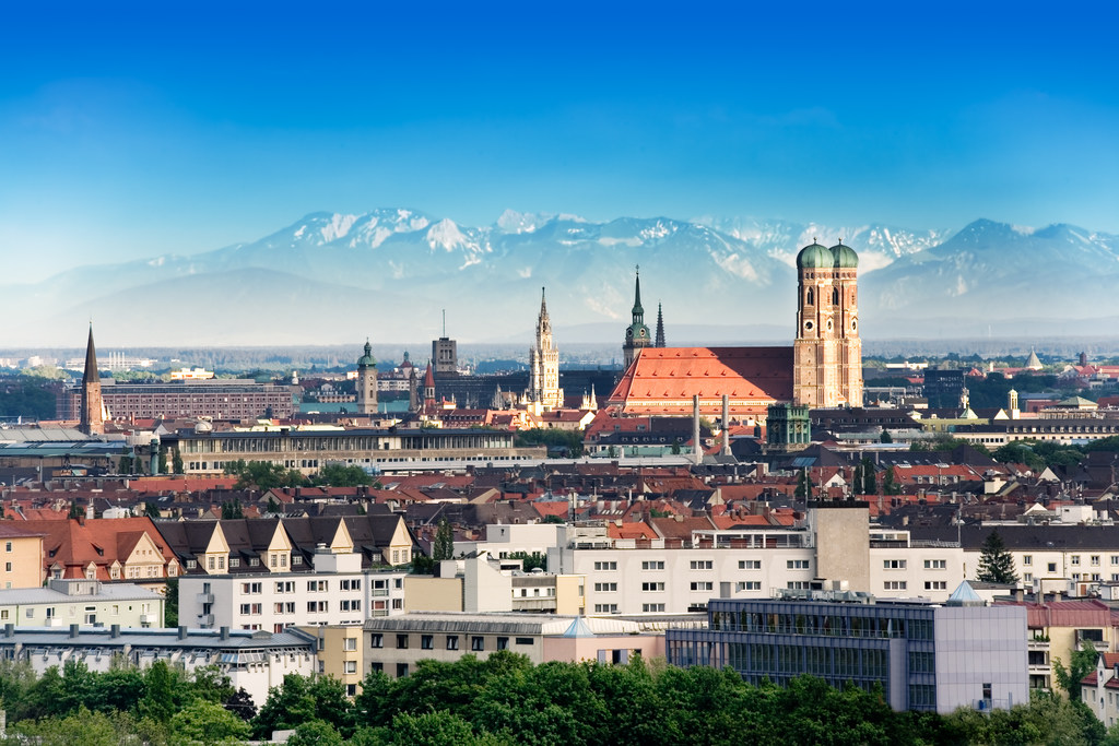 Munich, capital city of Germany's Free State of Bavaria. CIty skyline in the evening light. The Alps visible in the background.